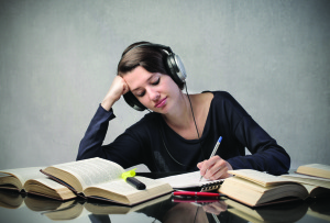81372991SS-Female-student-listening-to-headphones-300x203